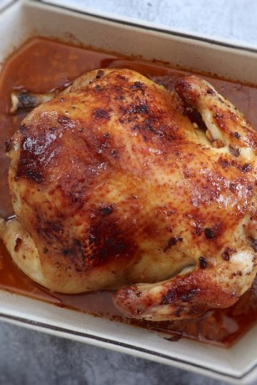 Roasted chicken with lemon and honey on a baking dish