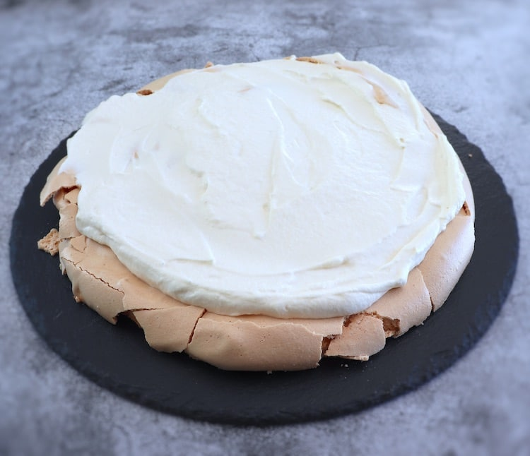 Pavlova with whipped cream on top